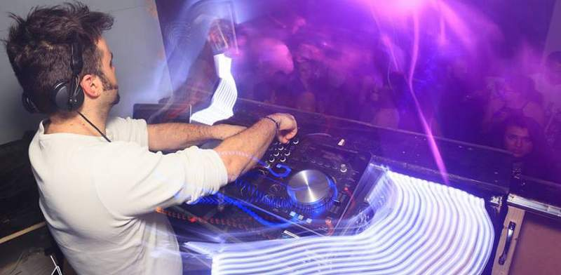 Platinum DJs DJ David C performs at a club in London.