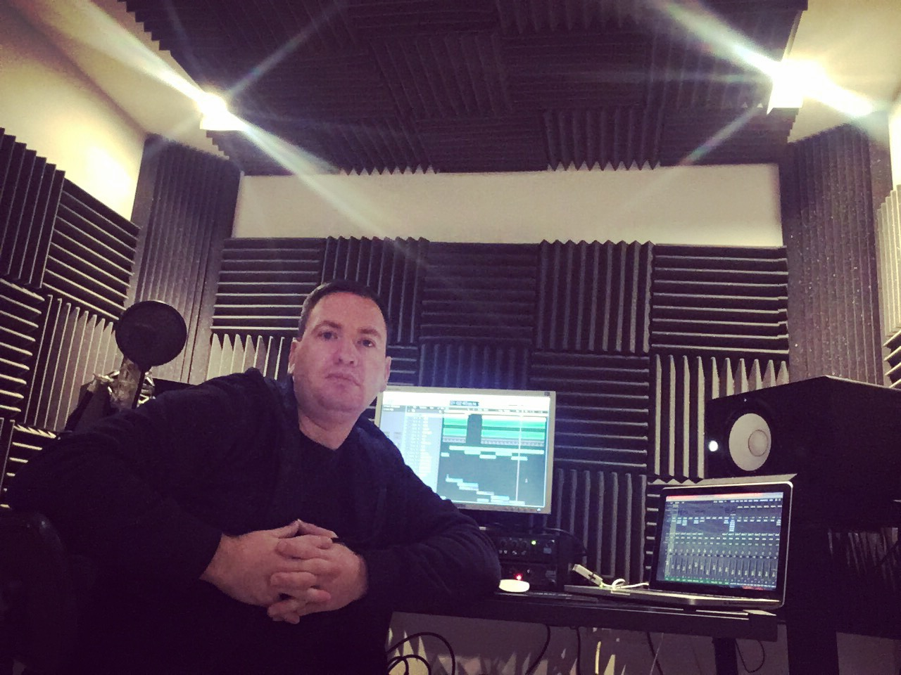 DJ Darrell in the studio producing music.