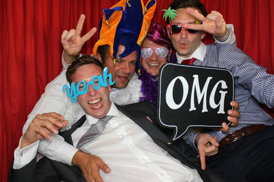 Fun with the photo booth at a birthday party in Kent.